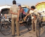 More rickshaw wallahs waiting for fares at Allahabad Train Station