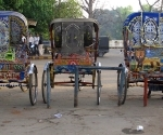 Parked cycle-rickshaw at Allahabad Train Station