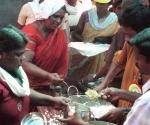 The men of Chettikulangra serve food to the women performing Pongala