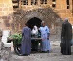 man-in-galabiyya-selling-cucumbers