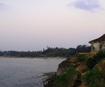 A dingy makes its way to Gokarna at sunset