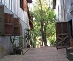Open shutter and doors in a Luang Prabang lane