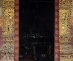 Snoozing at the entrance to Wat Xieng Muang