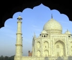 The morning sun on on the Taj Mahal, through an Indian arch