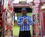 The man pictured, who sells garlands and other Hindu paraphernalia, thought that this picture looked like the image of a god