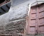 Varanasi close lanes are heemed in by multi-storey building that keep the light and heat out