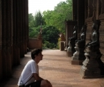 Inspecting a Buddha at Wat Haw Phra Kaew