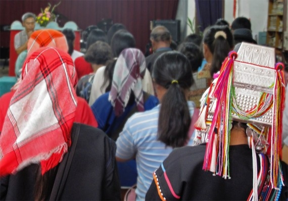 A mostly Akha congregation sing a hymn at Mae Salong's Methodist church