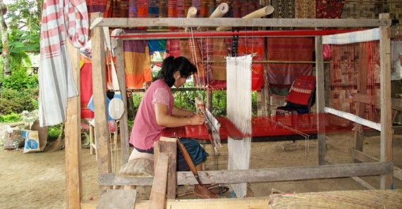 A woman weaving at the Saelao project in Vang Vieng