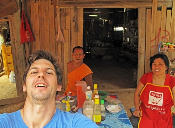 The proprietor of a shop in Ban Noun Savath, a monk, and me