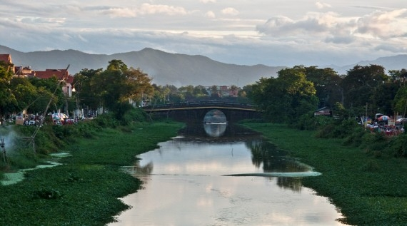 A bridge over the canalised Ngu Ha River in Hue