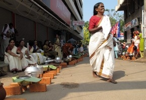 Women line up outside Sri Kanteswaram Temple, down a narrow lane beside Omkar Lodge, during Attukal Pongala