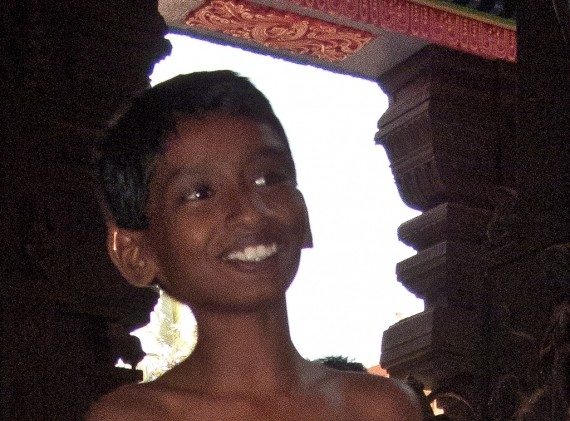 A boy smiling at he proceeds through the Attukal Devi Temple
